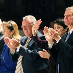 Elder David A. Bednar of the Quorum of the Twelve Apostles and Sister Susan Bednar applaud at the end of the cultural celebration for the Star Valley Wyoming Temple in Afton, Wyoming, on Saturday, Oct. 29, 2016.