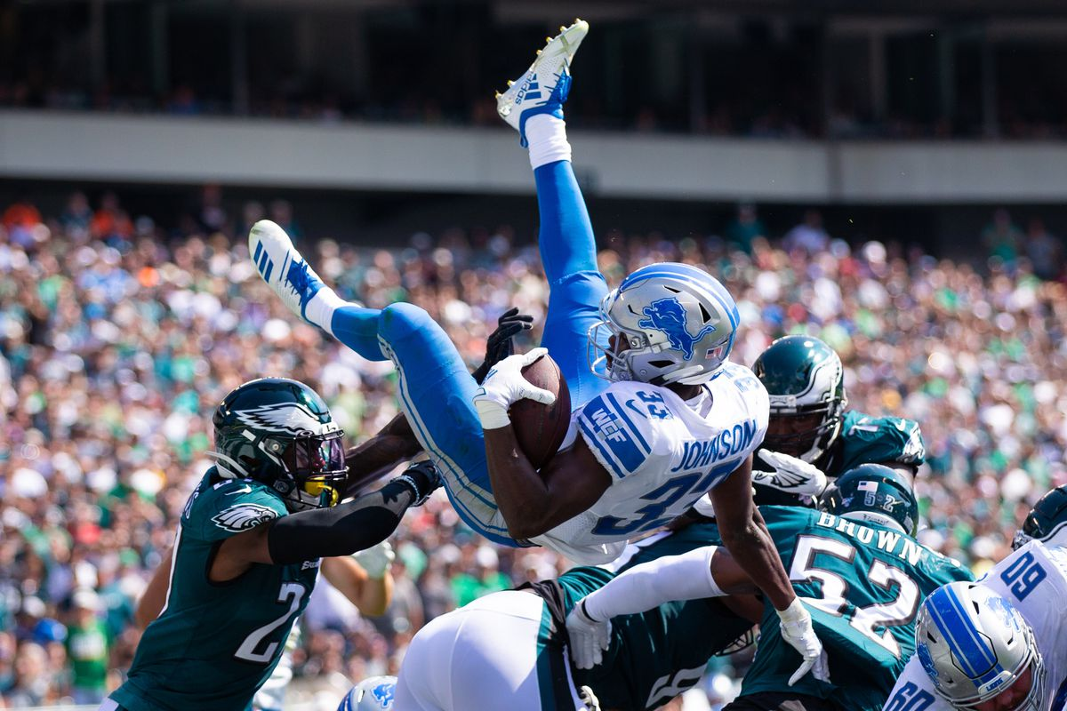 Detroit Lions running back Kerryon Johnson leaps over the pile for a touchdown against the Philadelphia Eagles during the second quarter at Lincoln Financial Field.
