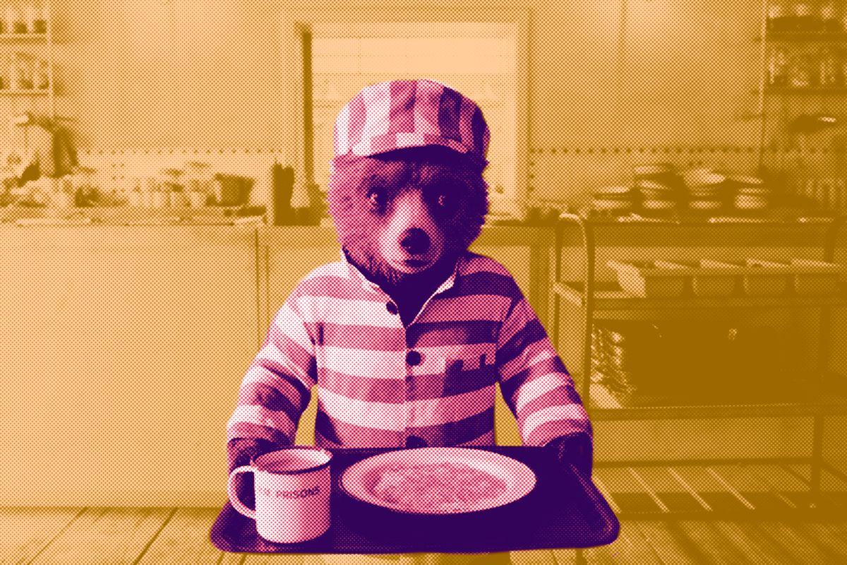 Paddington Bear wearing a prison uniform