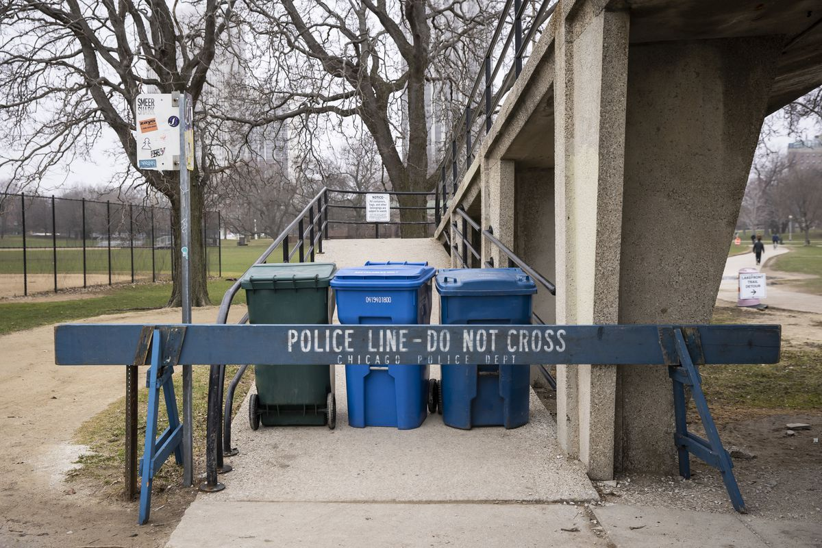 Chicago police blocked access to the Lake Shore Drive pedestrian bridge leading to the Lakefront Trail at North Avenue Beach in March after the city closed the area to pedestrians amid fears of the coronavirus pandemic.