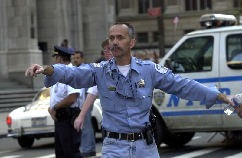 Chicago police Officer John Paskey directs traffic outside St. Patrick's Cathedral in New York on Sept. 17, 2001.