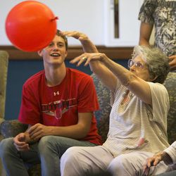Union football player D.J. Allen and other teammates play with Uintah Basin Rehabilitation and Senior Villa residents Peggy Fackerell and Mary Carter in Roosevelt on Tuesday, Sept. 24, 2013. The football coaches at Union High School have taken a stand against poor performance in the classroom and bullying outside the classroom, including disrespect of teachers and students.