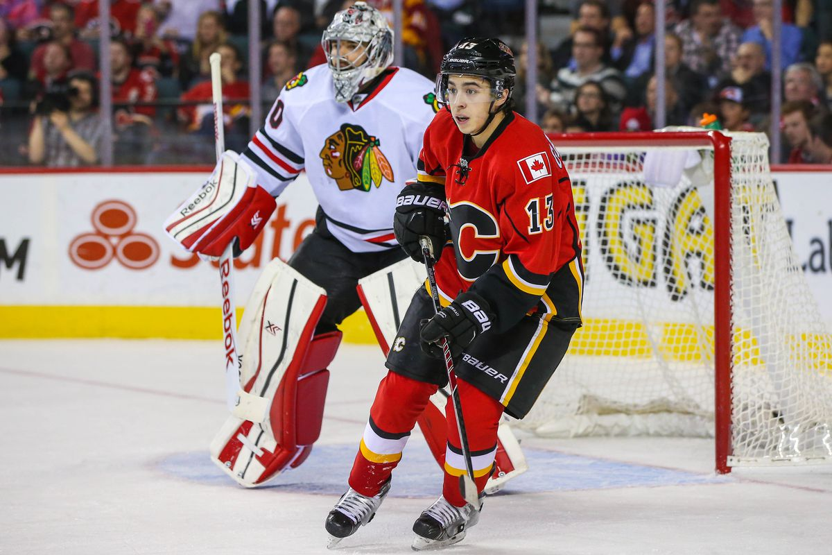 Gaudreau trying his best to screen Corey Crawford.