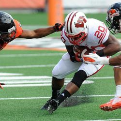 Oregon State's D.J. Welch (4) and Jordan Poyer (14) defend against Wisconsin's James White (20) during the second half of their NCAA college football game in Corvallis, Ore., Saturday, Sept. 8, 2012.