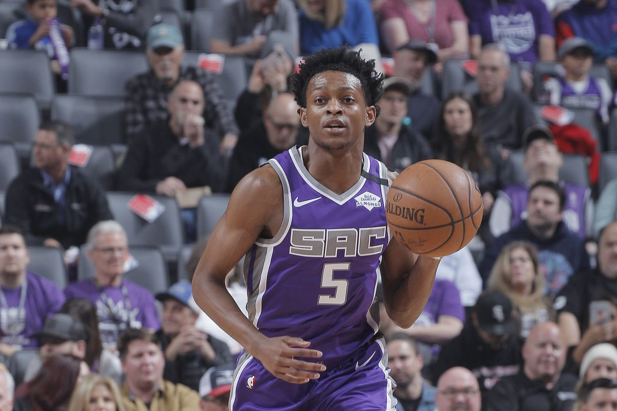 De'Aaron Fox of the Sacramento Kings brings the ball up the court against the Toronto Raptors on March 8, 2020 at Golden 1 Center in Sacramento, California.