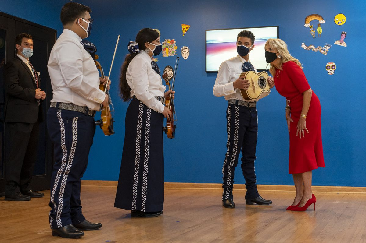 First lady Jill Biden, right, talks with musicians, from left, Luis Marquez, 17, Suesan Jarquin, 17, and Edwin Perez, 17, all with Chicago Mariachi Project during a visit and tour of the National Museum of Mexican Art in Pilsen on Tuesday.