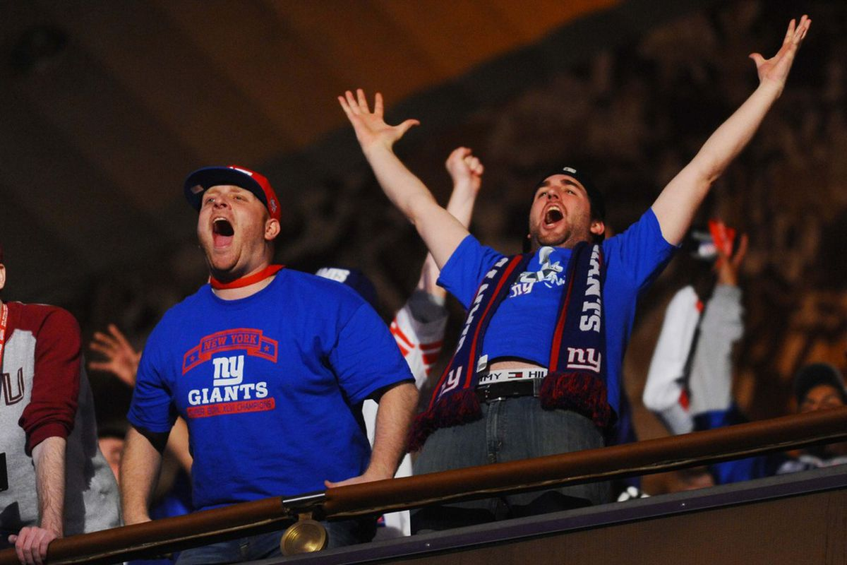 New York Giants fans react to the Giants selection of Virginia Tech running back David Wilson (not pictured) as the 32nd pick in the 2012 NFL Draft at Radio City Music Hall. James Lang-US PRESSWIRE