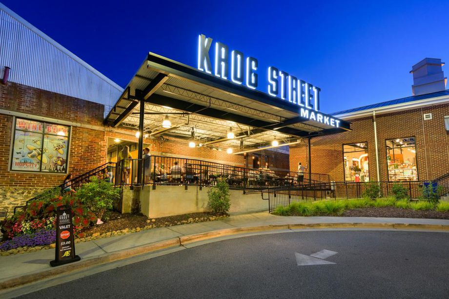 """A big entrance to an old brick building with the words """"Krog Street Market"""" over the top."""