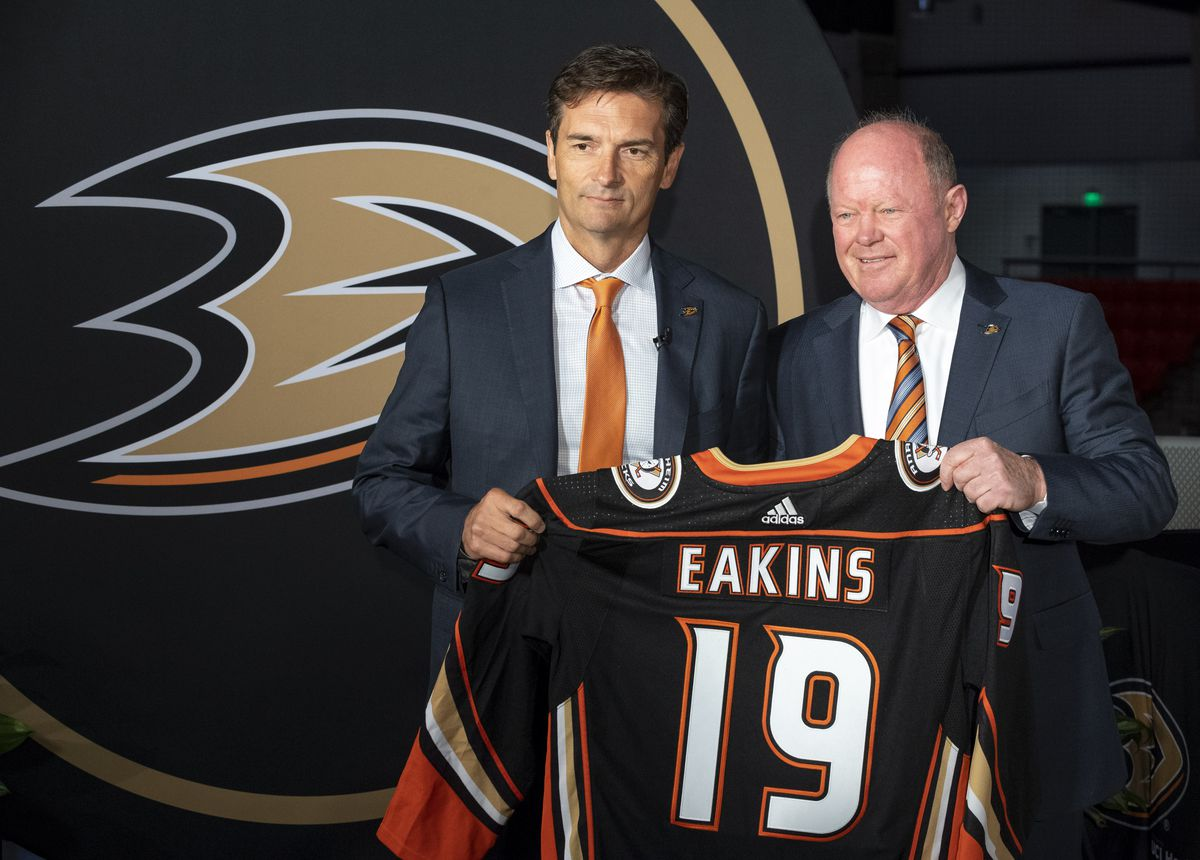 IRVINE, CA - JUNE 17: The new Anaheim Ducks Head Coach Dallas Eakins, left, was presented with a Ducks jersey by General Manager Bob Murray during a press conference at Great Park Ice in Irvine, CA on Monday, June 17, 2019. Eakins is the Ducks 10th head c