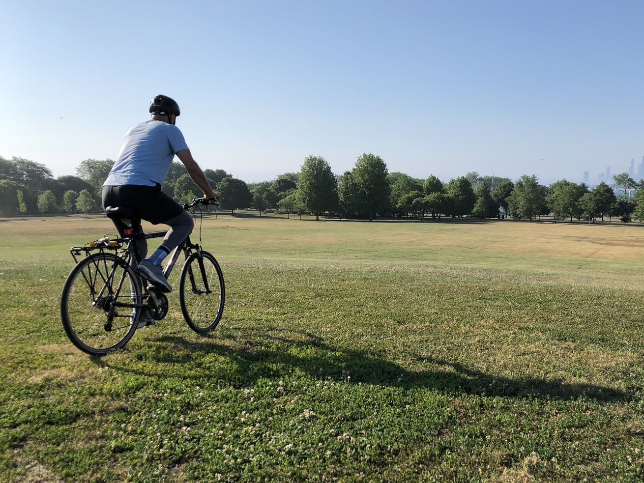 A bicyclist prepares to descend Cricket Hill Friday morning.