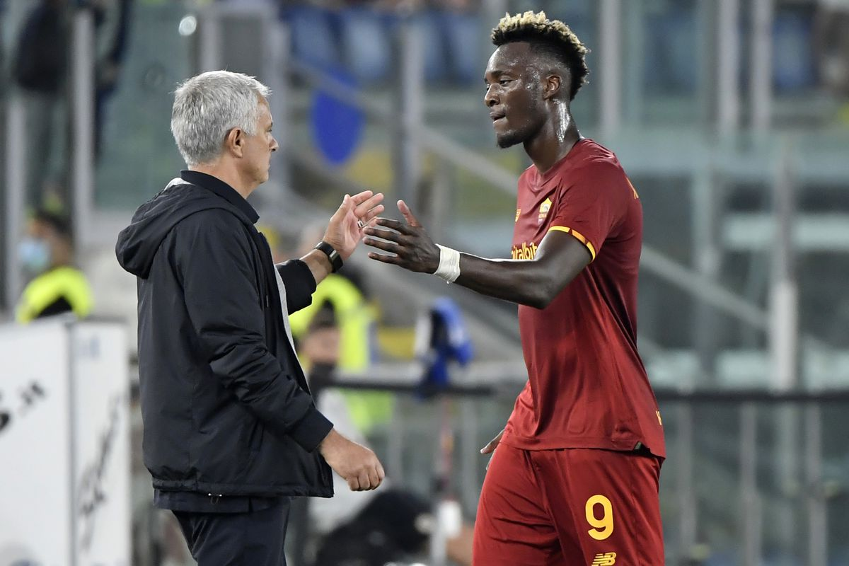 Jose Mourinho coach of AS Roma greets Tammy Abraham during...