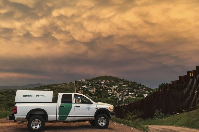 A US Border Patrol agent watches over the US-Mexico border in Nogales, Arizona, on July 22, 2018.