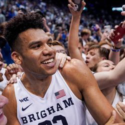 Brigham Young Cougars forward Yoeli Childs (23) celebrates with fans who rushed the court after BYU toppled No. 2-ranked Gonzaga 91-78 at the Marriott Center in Provo on Saturday, Feb. 22, 2020.