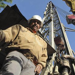 Jorge Vargas, a foreman for Maggiora Brothers Drilling Inc., poses for a photograph while drilling an 800-foot-deep water well at an almond farm in Chowchilla, Calif., on Friday, April 4, 2014. In California's drought, well drillers are experiencing a boom in business because farmers are relying more on ground water to irrigate their crops.