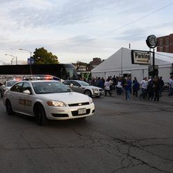 4:46 p.m. VIP motorcade pulls up to Ricketts private party tent, on Addison across from Wrigley Field -