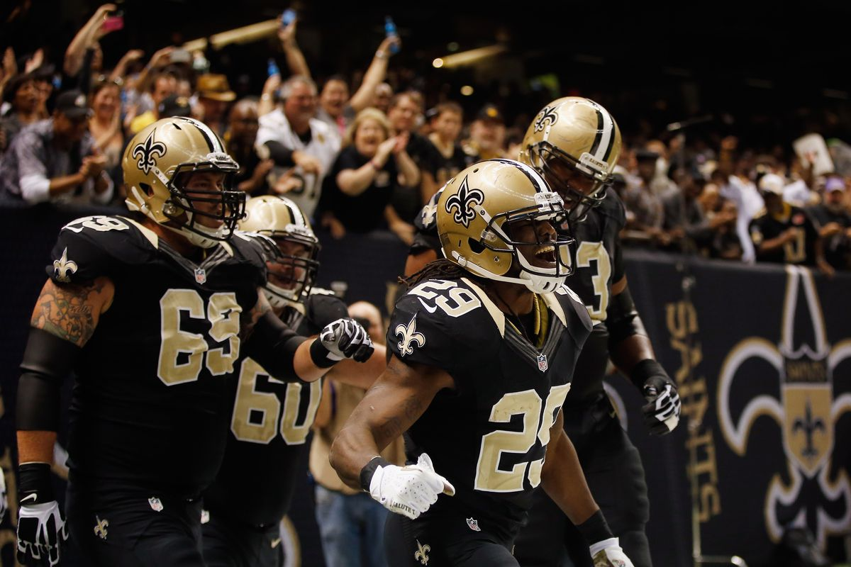 NEW ORLEANS, LA - New Orleans Saints running back Chris Ivory (29) celebrates after scoring a touchdown against the Atlanta Falcons defense at the Mercedes-Benz Superdome.