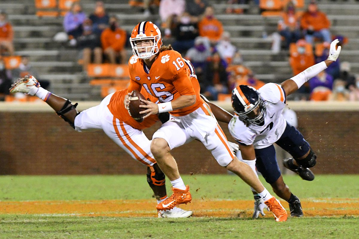 Clemson Tigers quarterback Trevor Lawrence scrambles up the field during the game between the Clemson Tigers and the Virginia Cavaliers on October 03, 2020 at Memorial Stadium in Clemson, South Carolina.