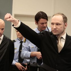 Anders Behring Breivik , right, gestures as the arrives in court to appear on charges relating to terrorism and multiple murders,  Monday morning April 16, 2012, in Oslo, Norway.  The trial against Breivik, an anti-Muslim fanatic who has confessed to killing 77 people in Norway, starts Monday amid worries that he will use the proceedings to showcase his radical views.