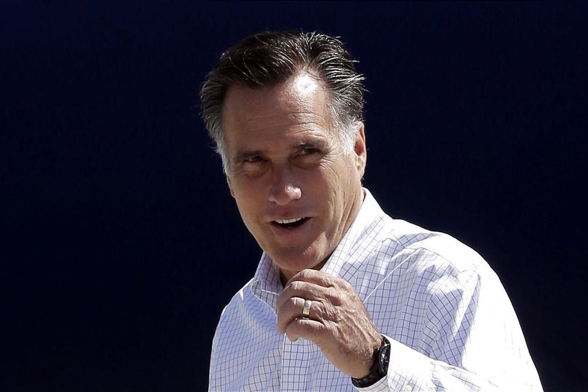 GOP presidential candidate Mitt Romney gets ready to board his campaign plane in Los Angeles on Sunday.