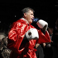 Former Massachusetts Gov. Mitt Romney enters the ring before his fight against Evander Holyfield during the Charity Vision Fight Night event in Salt Lake City, Friday, May 15, 2015.