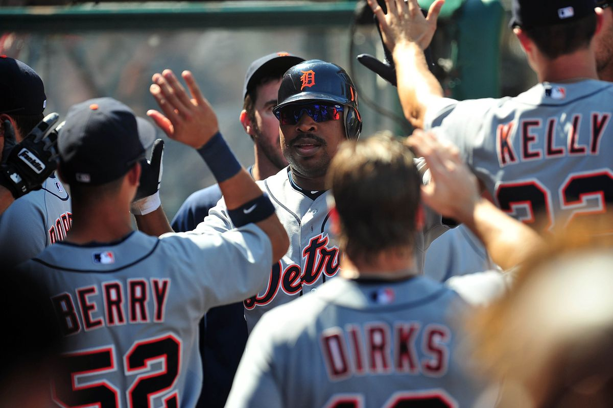 September 9, 2012; Anaheim, CA, USA; Detroit Tigers designated hitter Delmon Young (21) is congratulated in the seventh inning after scoring a run against the Los Angeles Angels at Angel Stadium. Mandatory Credit: Gary A. Vasquez-US PRESSWIRE