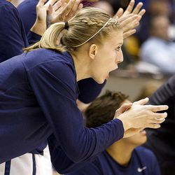 Ashley Garfield cheers on her teamates in the final minutes of BYU's game against the San Francisco Dons, in the Marriott Center  February 16, 2012