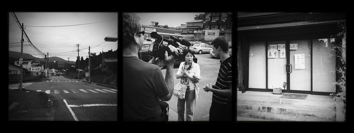 Set of three black and white photos taken in Fukushima following the 2011 tsunami and nuclear disaster. On the left: An empty road. In the middle: A camera crew interviews a woman in a parking lot. On the right, a shutter building.