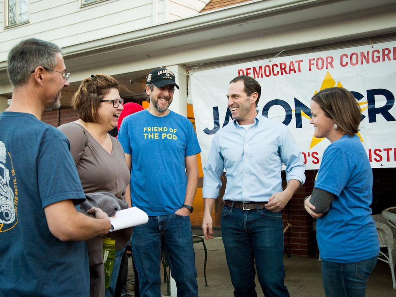 Democratic candidate Jason Crow (second from right) speaks with volunteers in Colorado's Sixth District.