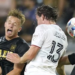 Los Angeles FC midfielder Bryce Duke, left, and Real Salt Lake midfielder Nick Besler try to head the ball during the second half of a Major League Soccer match Saturday, July 17, 2021, in Los Angeles. LAFC won 2-1.