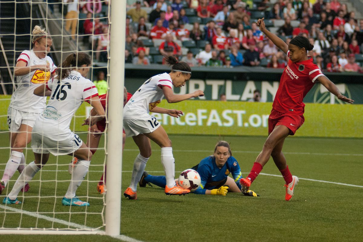 Jessica McDonald pokes home a second goal for the Thorns.
