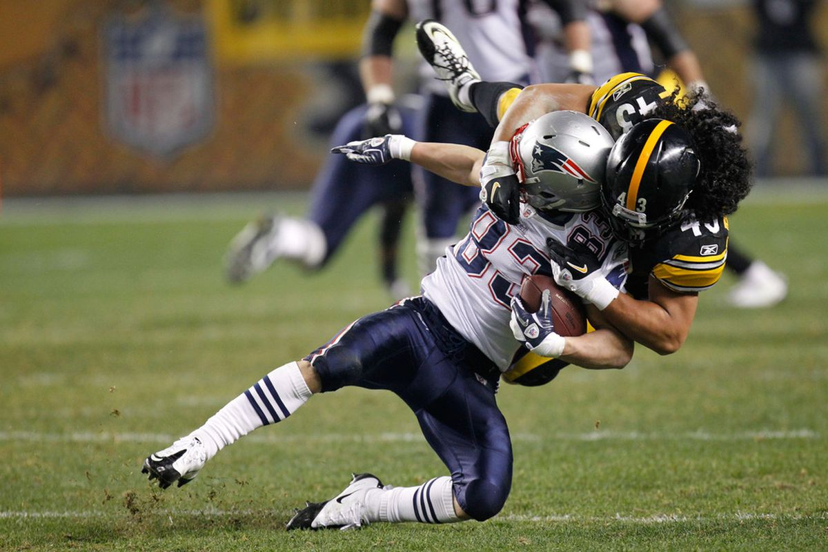 PITTSBURGH, PA - OCTOBER 30:  Wes Welker #83 of the New England Patriots is tackled Troy Polamalu #43 of the Pittsburgh Steelers at Heinz Field on October 30, 2011 in Pittsburgh, Pennsylvania.  (Photo by Gregory Shamus/Getty Images)