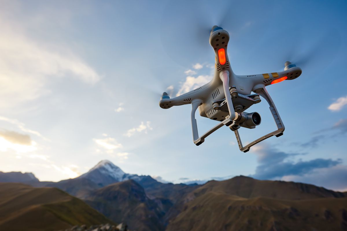 A picture of a drone flies over mountains