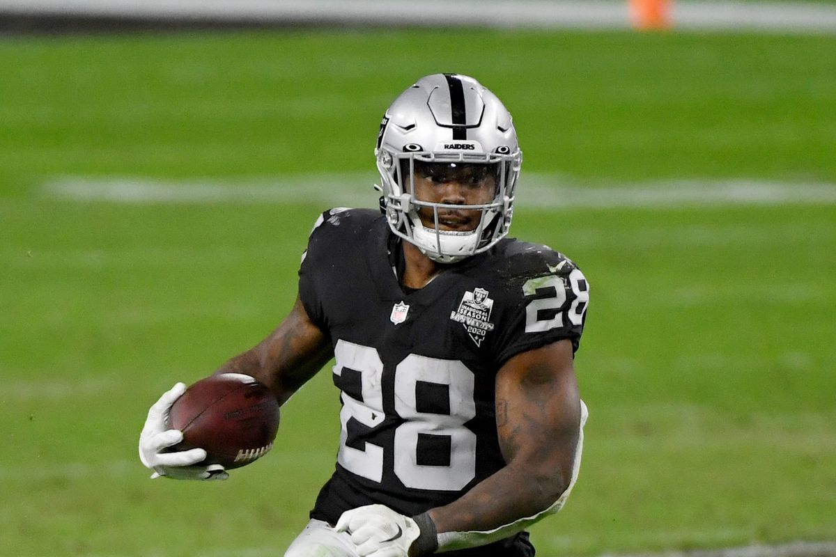 Running back Josh Jacobs #28 of the Las Vegas Raiders runs against the Kansas City Chiefs in the second half of their game at Allegiant Stadium on November 22, 2020 in Las Vegas, Nevada.