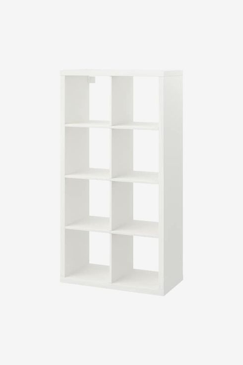 White shelf with square openings.