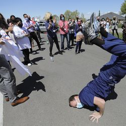 Registered nurse Ryan Davis break dances during an Alex Boyé concert outside of Lakeview Hospital in Bountiful on Tuesday, May 4, 2021.