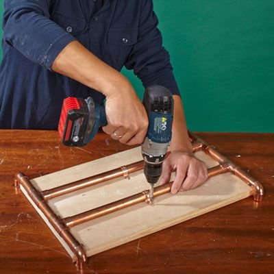 Man Attaches Base Frame To Deck Of Log Holder