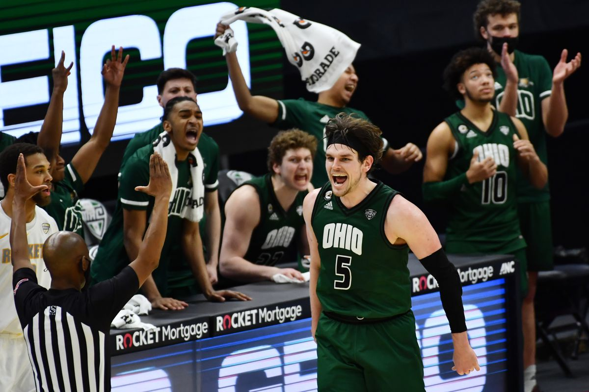 Ohio Bobcats forward Ben Vander Plas and the Bobcat bench celebrate after Vander Plas made a three point basket against the Toledo Rockets during the second half at Rocket Mortgage FieldHouse.