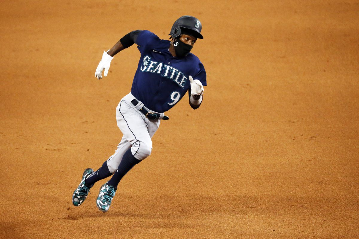 Seattle's Dee Gordon runs to third base in a game against the Texas Rangers earlier this month. The Mariners have more Black players on their roster than the five teams in the AL Central combined.