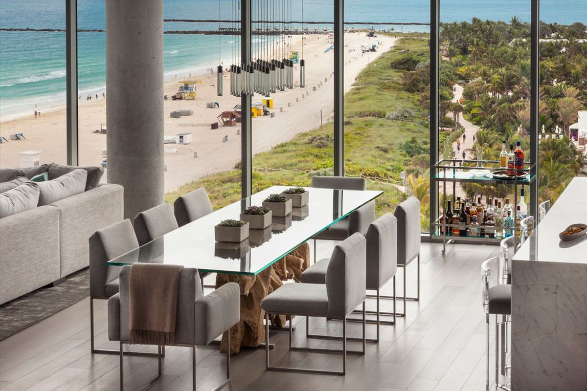 Living room in a modern penthouse in Miami Beach with the ocean and beach in the background down below