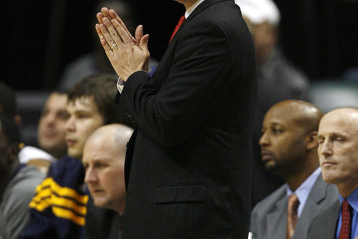 Apr 23, 2012; Indianapolis, IN, USA; Indiana Pacers coach Frank Vogel coaches on the sidelines during a game against the Detroit Pistons at Bankers Life Fieldhouse. Indiana defeats Detroit 103-97.  Mandatory Credit: Brian Spurlock-US PRESSWIRE