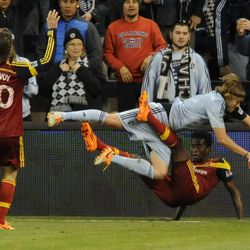 Real Salt Lake's Abdoulie Mansally and Sporting KC's Chance Myers collide out of bounds during a game at Sporting Park in Kansas City, Kan., on Saturday, April 5, 2014.