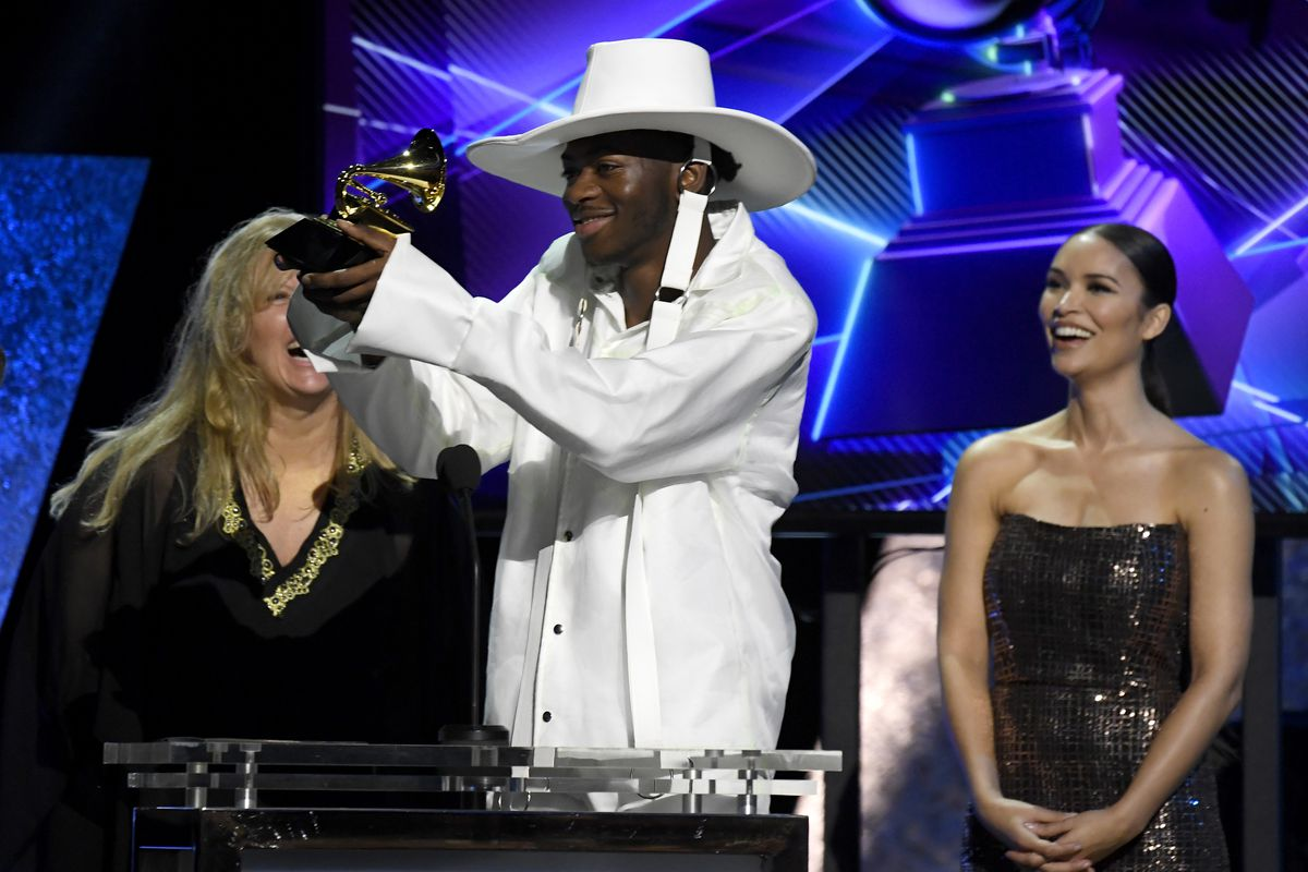 """Lil Nas X accepts the Best Music Video award for """"Old Town Road"""" onstage during the 62nd Annual GRAMMY Awards Premiere Ceremony at the Microsoft Theater on Sunday in Los Angeles."""