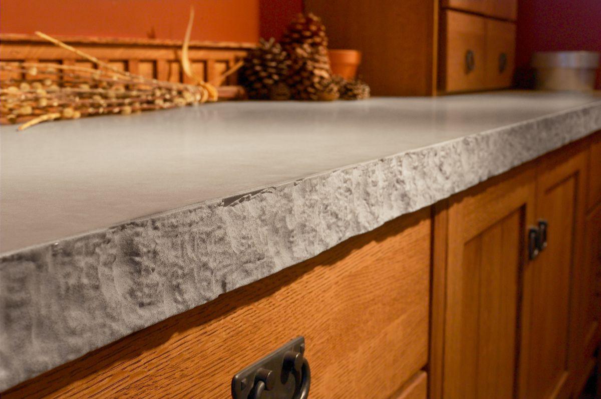 Quartz kitchen countertop with rough edges in desert limestone.
