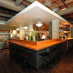 The Squeaky Bean's open kitchen showcases a chef's counter.