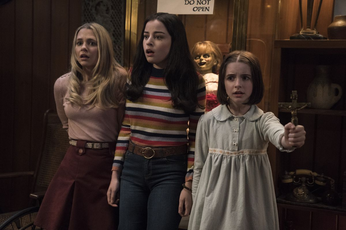 """Madison Iseman (from left, as Mary Ellen), Katie Sarife (as Daniela) and McKenna Grace as Judy Warren in a scene from the horror film """"Annabelle Comes Home."""""""