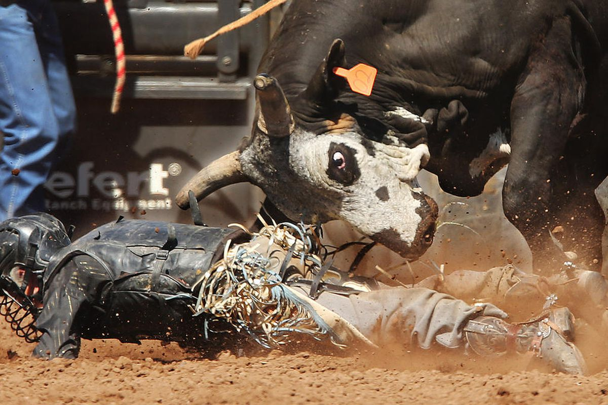 Briggs Madsen is thrown during bull riding during the Utah State High School Rodeo Finals in Heber on Wednesday, May 31, 2017.