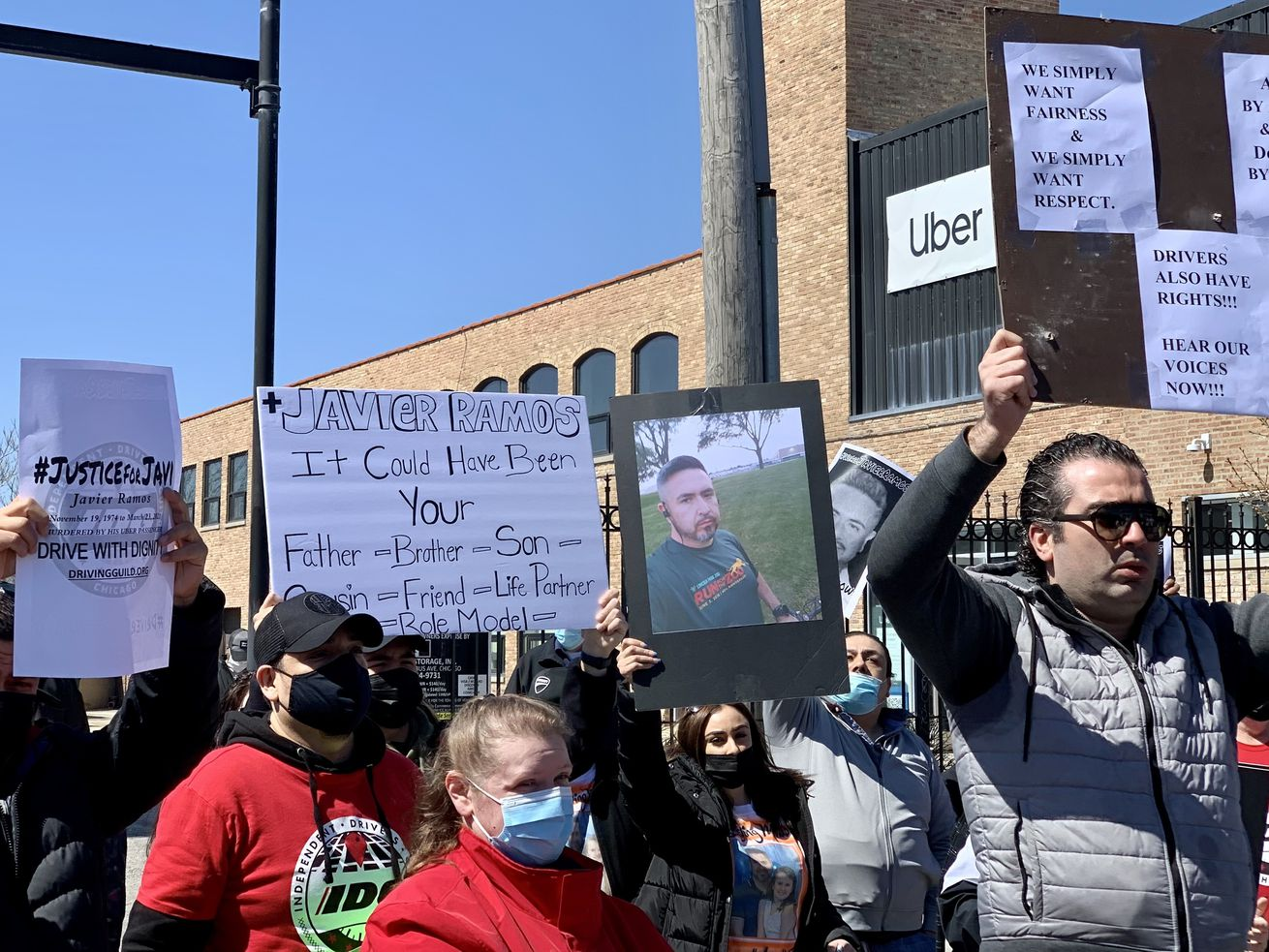 The Independent Drivers Guild Chicago gathered in protest, calling on Uber, Lyft and other ride share companies to do more to protect them.