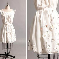 """Brooklyn Industries <a href=""""http://www.wordsfromthewatertower.com/?p=4162'>just released</a> the Seed Dress, which is 100% biodegradable and decorated with real seeds. They're also selling Seed Bomb bracelets, and they've installed Seed Bomb vending mach"""