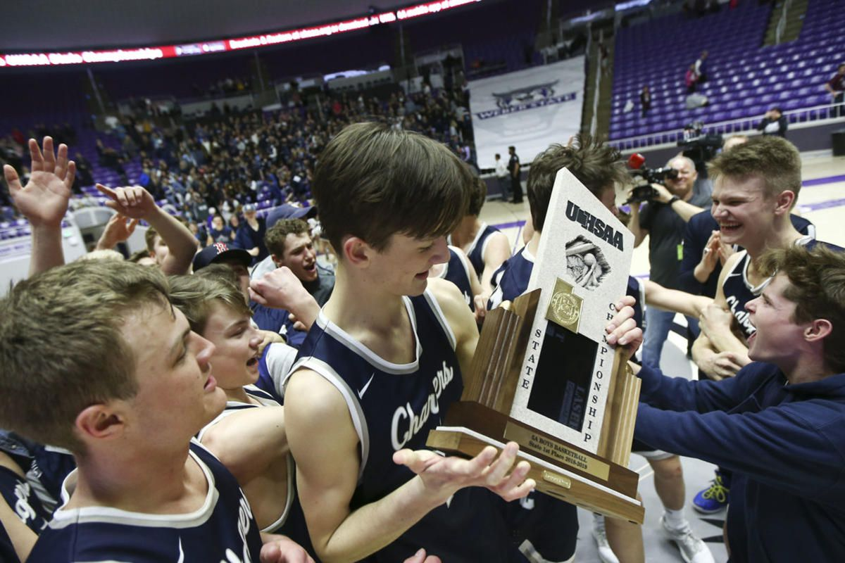 The Corner Canyon Chargers celebrate beating the Jordan Beetdiggers to win the 5A Championship game at the Dee Events Center in Ogden on Saturday, March 2, 2019.
