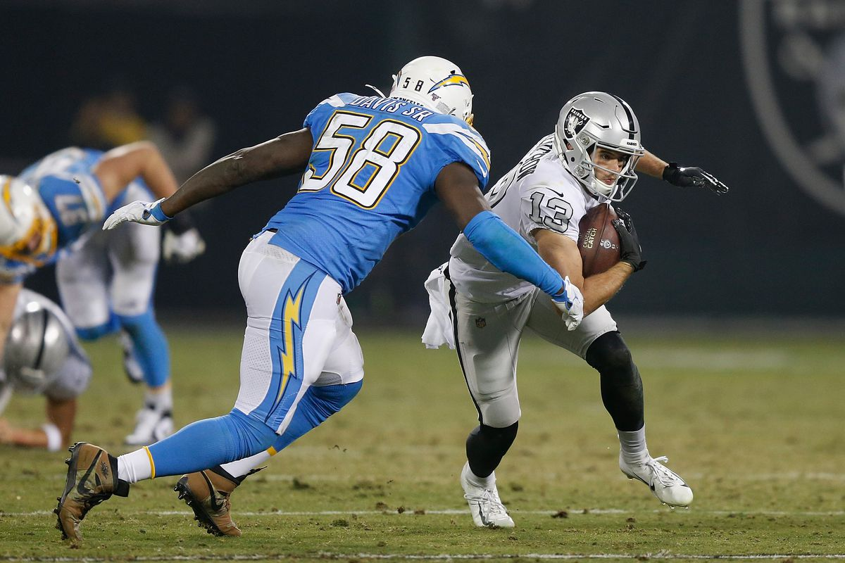 Hunter Renfrow of the Oakland Raiders is tackled by Thomas Davis of the Los Angeles Chargers in the fourth quarter at RingCentral Coliseum on November 07, 2019 in Oakland, California.